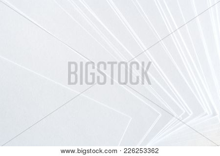 White Background From Clean Paper Sheets Laid Out Carelessly.