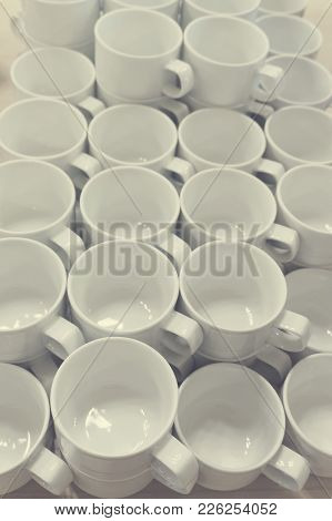 A Lot Of Empty White Porcelain Cups On A Table