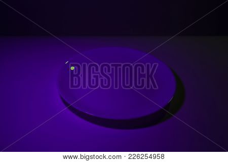 Abstract Picture Of Simple Ceramic White Dish Lit By Two Lights In Ultraviolet Contrasting Colors. V