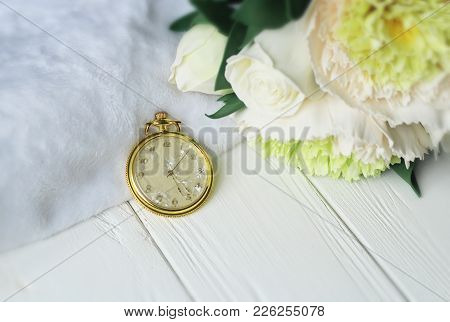 Background With White Alarm Clock And Pink Roses On White Painted Wooden Planks. Place For Text.