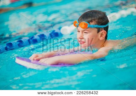 Boy Practice Swimming And Swimming Freestyle In The Pool