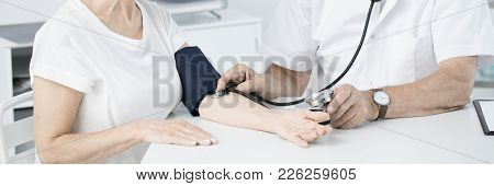 Doctor Measuring Pressure