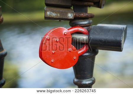 Many Padlocks Of Lovers Wich Hang On Bridge Railings