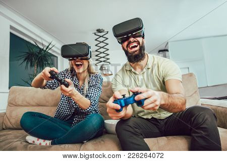 Happy Friends Playing Video Games With Virtual Reality Glasses - Young People Having Fun With New Te