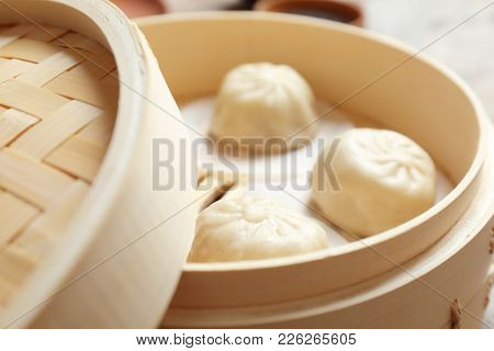 Bamboo steamer with tasty baozi dumplings, closeup