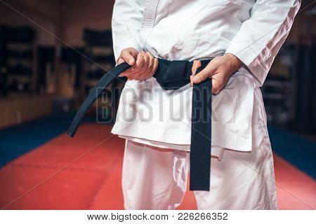Male person in white kimono with black belt