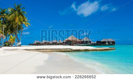 Beautiful Tropical Landscape With Wooden Villasabove The Crystal Turquoise Water Of The Indian Ocean