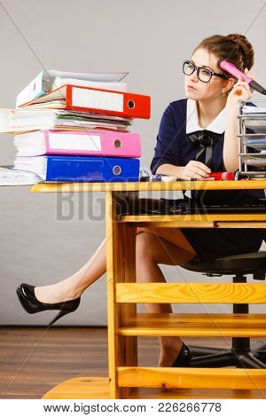 Sleepy Business Woman Doing Her Work Sitting Working At Desk Full Off Documents In Binders Being Bor