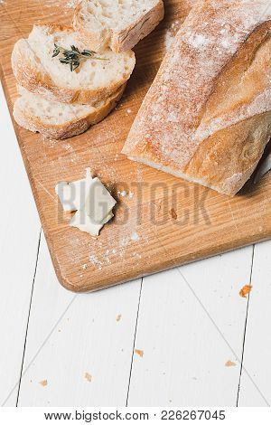 The Fresh Bread On A White Wooden Table Background. Front View. The Healthy Eating And Traditional B