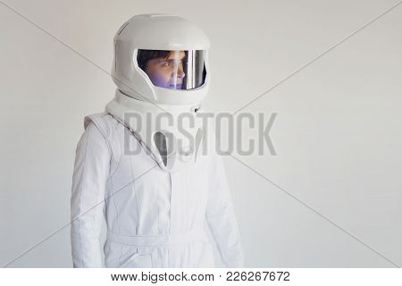 Astronaut In Helmet Looking To The Right. Fantastic Space Suit. Exploration Of Outer Space.