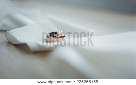 Panoramic Banner Of Two Gold Wedding Rings Of Love And Romance On A Background With Copy Space For Y