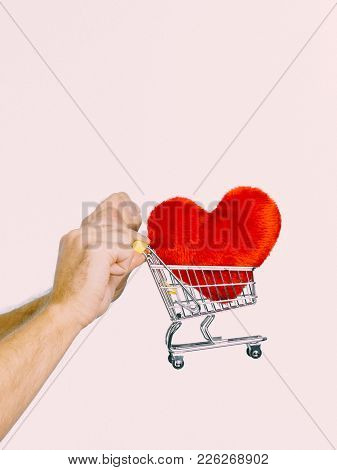 Male Hands Holding Shopping Basket Cart With Red Heart. Love, Valentines Day, Charity Sharing Concep