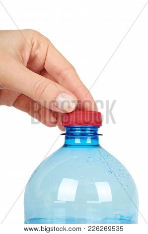 Eco Plastic Bottle With Water, In Hand, Isolated On White Background.