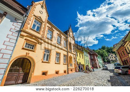 Sighisoara, Romania - July 4, 2016: View On Town Houses On School Street On The Old Town Of Sighisoa