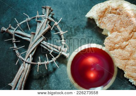Holy Communion On Wooden Table On Church.taking Communion.cup Of Glass With Wine, Bread And Holy Bib