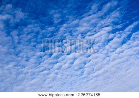 White Cirrus Clouds Against Blue Sky. Light, Airy, White, Cumulonimbus Clouds In  Bright Blue Sky On