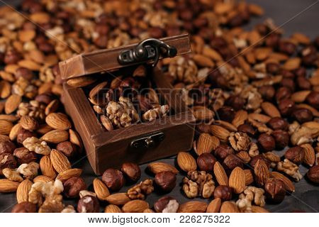 Open Wooden Box Full Of Nuts. Background Of Mix Nuts: Hazelnuts, Walnuts And Almonds