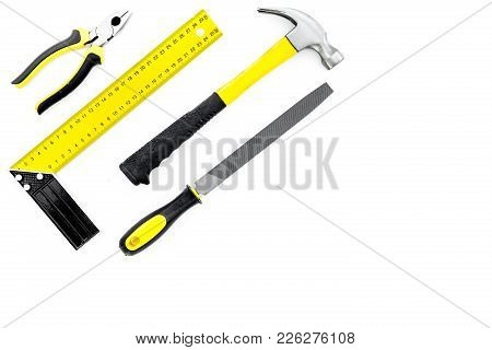 Tools For Repair And Building. Hummer, File, Corner Ruler On White Background Top View.