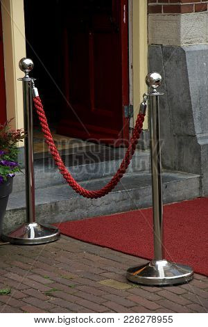 Big Metal Poles And Red Rope Barriers On Vip Entrance
