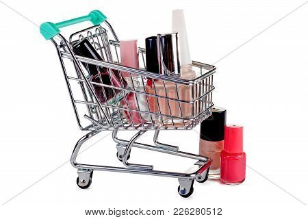 Supermarket Trolley With Nail Polish. Concept - Sales And Discounts On Cosmetics.