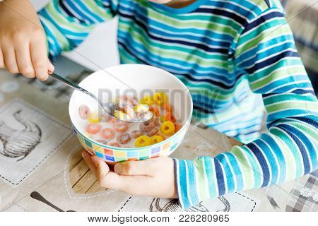 Little School Kid Boy Eating Cereals With Milk And Berries, Fresh Strawberry For Breakfast Or Lunch.