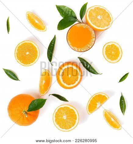 Top View Of Orange Juice In A Glass And Whole And Slices Of Orange Fruits With Green Leaves Isolated