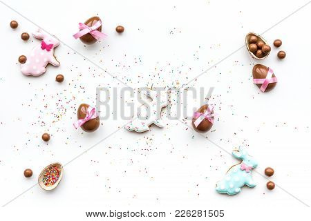 Celebrate Easter. Modern Signs Of Easter. Chocolate Easter Eggs And Easter Bunny Cookies. White Back
