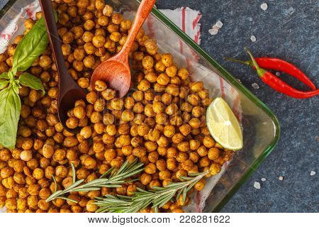 Healthy Snack - Baked Spicy Chickpeas In Glass Dish. Healthy Vegan Food Concept.