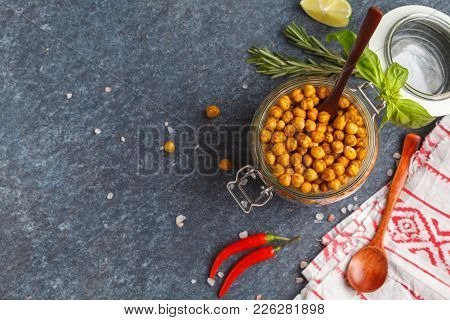 Healthy Snack - Baked Spicy Chickpeas In Glass Jar. Healthy Vegan Food Concept.