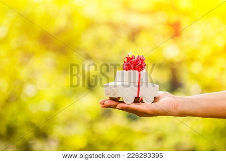 The Buying A New Chattel As A Gift To Family Or The One Loved Concept, Woman Hand Holding A Car Mode