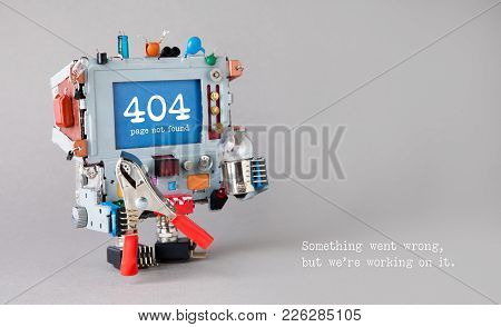 404 Error Page Not Found. Handyman Robot With Red Pliers Light Bulb On Gray Background. Text Message