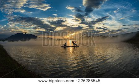 Hanoi, Vietnam - June 12, 2016: Dong Mo Lake With A Couple Of Fishers Catching Fish By Net Trap In B