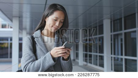 Asian Business woman using mobile phone at outdoor