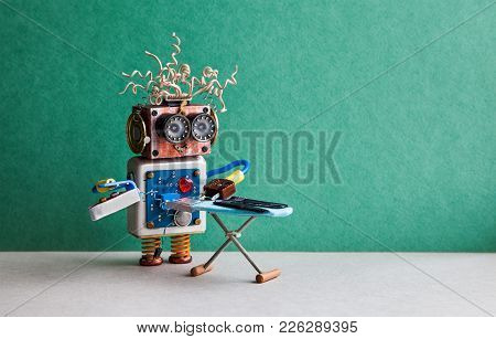 Robot Helpmate Ironing Black Pants With Iron On The Board. Green Wall Gray Floor Room Interior. Crea