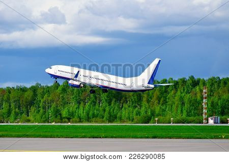 Airplane With Blank Livery Taking Off The Runway Travel Background With Commercial Airplane Ready To