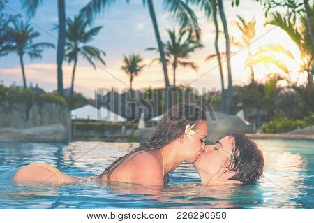 Portrait Of Happy Couple, Closeup Body At Swim At The Swimming Pool. Traveling At Bali. Open-air Swi