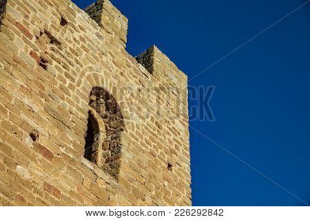 Castle Battlements, Merlons And Window Against Blue Sky
