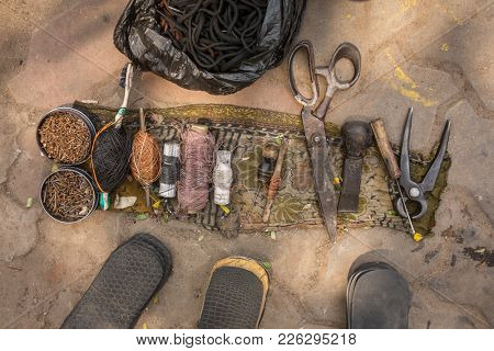 Indian street shoemaker tools close up