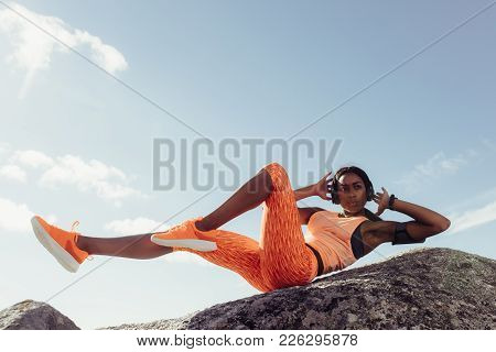 Fit Woman Stretching At The Beach