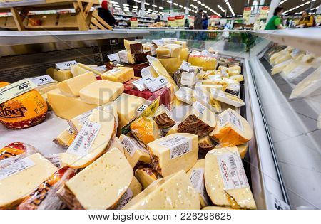 Samara, Russia - February 11, 2018: Tasty Freshly Cheese Ready To Sale In The Showcase At The Superm