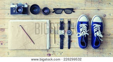 Outfit Of A Stylish Traveler. Set Of Different Objects And Equipment: Album, Glasses, Camera, Lenses