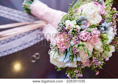 Beautiful Bridal Bouquet And Engagement Rings In Blur, Selective Focus. Wedding Bouquet And Rings, C