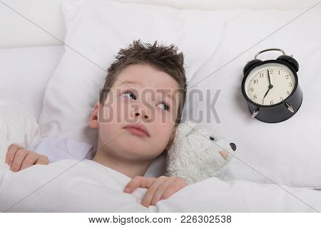 The Boy Wakes Up And Looks At The Alarm Clock, How Much Time Is Left