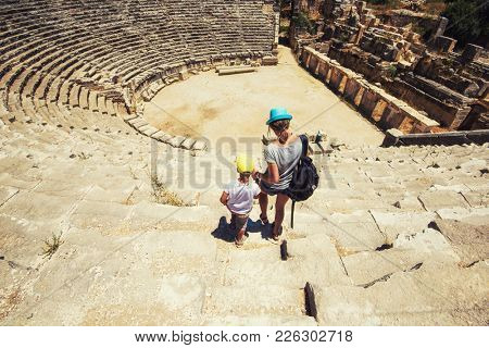 Young woman and her son at theatre in Myra ancient city of Antalya in Turkey.