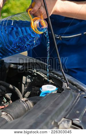 Refueling The Car With A Glass Cleaner, Under The Hood