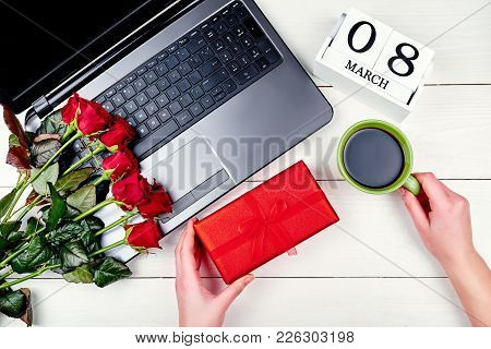 Woman Holding Gift Box And Cup Of Coffe. Womens Day Background With Bouquet Of Red Roses; Gift Box;