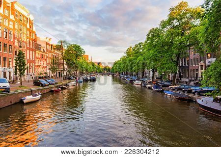 Amsterdam, The Netherlands - June 10, 2014: Beautiful View Of Canal In Amsterdam. Amsterdam Is The C