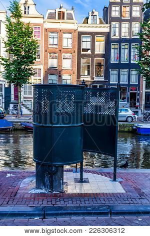 Amsterdam, The Netherlands - June 10, 2014: Public Urinal In Street Of Amsterdam Called Krul. De Kru