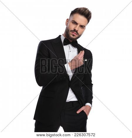 angry and arrogant man snapping his fingers on white background