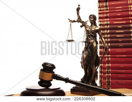 justice goddess , gavel and law books on white background